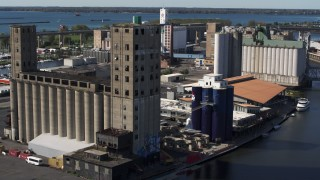 DX0002_201_025 - 5.7K stock footage aerial video of an orbit around a large grain elevator in Buffalo, New York