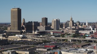 DX0002_201_028 - 5.7K stock footage aerial video of flying by the city's skyline behind Sahlen Field baseball stadium, Downtown Buffalo, New York
