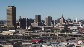 DX0002_201_030 - 5.7K stock footage aerial video flyby the city's skyline behind Sahlen Field baseball stadium, Downtown Buffalo, New York