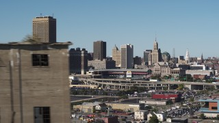 DX0002_201_032 - 5.7K stock footage aerial video of the city's skyline behind baseball stadium, reveal grain elevator, Downtown Buffalo, New York