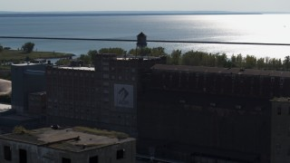 DX0002_201_036 - 5.7K stock footage aerial video of a water tower on a flour mill in Buffalo, New York