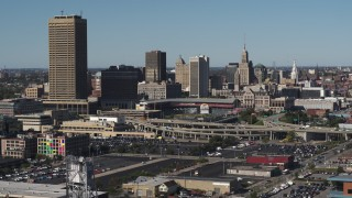 DX0002_201_041 - 5.7K stock footage aerial video ascend for view of the baseball stadium and skyline in Downtown Buffalo, New York