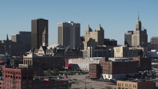DX0002_202_001 - 5.7K stock footage aerial video of One M&T Plaza while flying near Erie Community College, Downtown Buffalo, New York