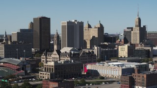 DX0002_202_002 - 5.7K stock footage aerial video reverse view of One M&T Plaza and Erie Community College, Downtown Buffalo, New York