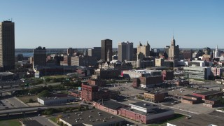DX0002_202_013 - 5.7K stock footage aerial video ascend away from Erie Community College, baseball stadium, office towers in Downtown Buffalo, New York