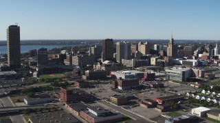 DX0002_202_014 - 5.7K stock footage aerial video approach Erie Community College, baseball stadium, office towers in Downtown Buffalo, New York