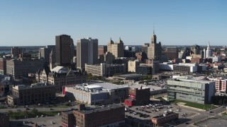 DX0002_202_018 - 5.7K stock footage aerial video reverse view of office towers near the community college in Downtown Buffalo, New York