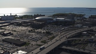 DX0002_202_022 - 5.7K stock footage aerial video of orbiting KeyBank Center arena and freeway, Downtown Buffalo, New York