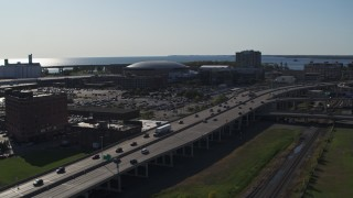 DX0002_202_024 - 5.7K stock footage aerial video focus on KeyBank Center arena and descend by freeway, Downtown Buffalo, New York