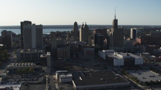 DX0002_203_006 - 5.7K stock footage aerial video descend and orbit a trio of office towers in Downtown Buffalo, New York