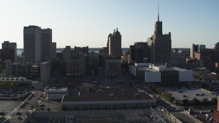 DX0002_203_007 - 5.7K stock footage aerial video descend and fly away from a trio of office towers in Downtown Buffalo, New York