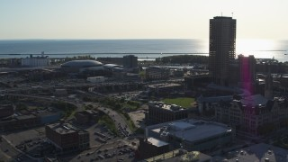 DX0002_203_009 - 5.7K stock footage aerial video arena and baseball stadium by skyscraper in Downtown Buffalo, New York
