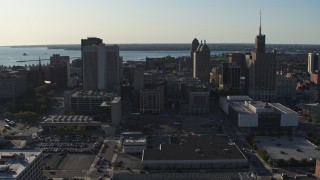 DX0002_203_015 - 5.7K stock footage aerial video of ascending past three tall office towers in Downtown Buffalo, New York