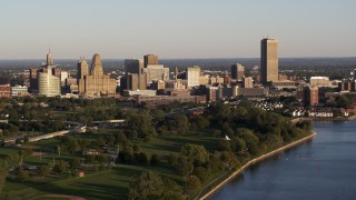 DX0002_203_030 - 5.7K stock footage aerial video a wide view of the city's skyline at sunset, Downtown Buffalo, New York