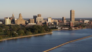DX0002_203_033 - 5.7K stock footage aerial video of the city's skyline at sunset, seen from Lake Erie, Downtown Buffalo, New York