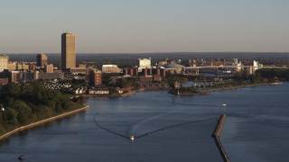 DX0002_203_041 - 5.7K stock footage aerial video of Seneca One Tower and Buffalo River at sunset, Downtown Buffalo, New York