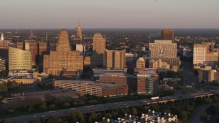 DX0002_204_002 - 5.7K stock footage aerial video of city hall beside courthouse and office buildings at sunset, Downtown Buffalo, New York