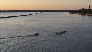 DX0002_204_012 - 5.7K stock footage aerial video of passing a rowboat and speedboat on Lake Erie at sunset, Buffalo, New York