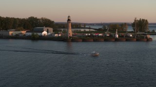 DX0002_204_017 - 5.7K stock footage aerial video approach Lake Erie lighthouse at sunset, Buffalo, New York
