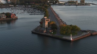 DX0002_204_021 - 5.7K stock footage aerial video ascend away from a lakeside observation deck at sunset, Buffalo, New York