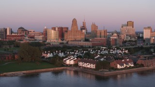 DX0002_204_025 - 5.7K stock footage aerial video a view of city hall and office buildings at sunset, seen from waterfront condos, Downtown Buffalo, New York