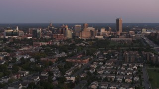 DX0002_204_029 - 5.7K stock footage aerial video of flying by the city's skyline at twilight, Downtown Buffalo, New York