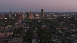 DX0002_204_030 - 5.7K stock footage aerial video of Seneca One Tower and the city's skyline at twilight, Downtown Buffalo, New York