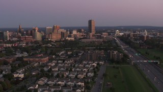 DX0002_204_032 - 5.7K stock footage aerial video wide view of Seneca One Tower and the city's skyline seen from I-190 at twilight, Downtown Buffalo, New York