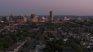 DX0002_204_034 - 5.7K stock footage aerial video wide view of Seneca One Tower and the city's skyline seen from homes at twilight, Downtown Buffalo, New York
