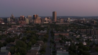 DX0002_204_035 - 5.7K stock footage aerial video of Seneca One Tower and the city's skyline while passing homes at twilight, Downtown Buffalo, New York