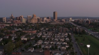 DX0002_204_036 - 5.7K stock footage aerial video of Seneca One Tower and skyline seen while passing homes at twilight, Downtown Buffalo, New York