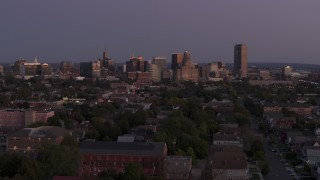 DX0002_204_039 - 5.7K stock footage aerial video of the skyline seen while descending near apartments at twilight, Downtown Buffalo, New York