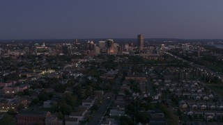 DX0002_204_043 - 5.7K stock footage aerial video of the skyline seen from apartments and homes at twilight, Downtown Buffalo, New York