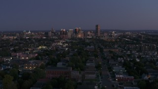 DX0002_204_044 - 5.7K stock footage aerial video of the skyline while passing by apartments and homes at twilight, Downtown Buffalo, New York