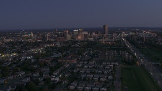 DX0002_204_045 - 5.7K stock footage aerial video of the skyline while ascending over neighborhoods at twilight, Downtown Buffalo, New York