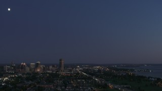 DX0002_204_048 - 5.7K stock footage aerial video of the moon high above the city's skyline at twilight, Downtown Buffalo, New York