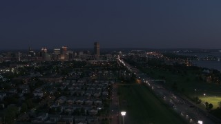 DX0002_204_050 - 5.7K stock footage aerial video flyby I-190 leading to skyline at twilight, Downtown Buffalo, New York