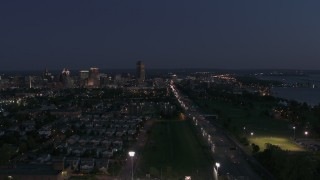 DX0002_204_051 - 5.7K stock footage aerial video reverse view of I-190 leading to skyline at twilight, Downtown Buffalo, New York