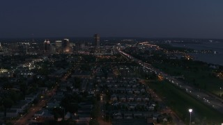 DX0002_204_054 - 5.7K stock footage aerial video wide view of Seneca One Tower and skyline at twilight, Downtown Buffalo, New York