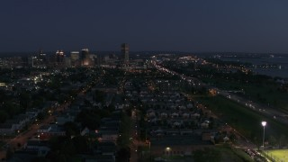 DX0002_204_055 - 5.7K stock footage aerial video descending with view of Seneca One Tower and skyline at twilight, Downtown Buffalo, New York