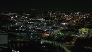 DX0002_205_001 - 5.7K stock footage aerial video of flying by the city skyline at night, Downtown Buffalo, New York