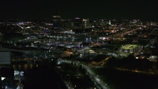 DX0002_205_003 - 5.7K stock footage aerial video of flying by the city skyline at night, Downtown Buffalo, New York