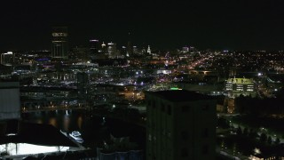 DX0002_205_006 - 5.7K stock footage aerial video flyby the skyline at night, reveal grain elevators, Downtown Buffalo, New York