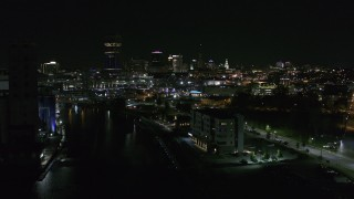 DX0002_205_009 - 5.7K stock footage aerial video of following Buffalo River toward the skyline at night, Downtown Buffalo, New York
