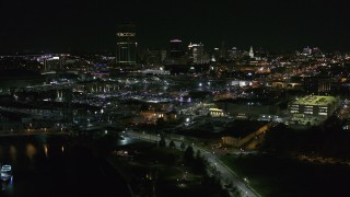 DX0002_205_012 - 5.7K stock footage aerial video of the skyline while descending by river at night, Downtown Buffalo, New York