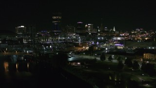 DX0002_205_013 - 5.7K stock footage aerial video approach the skyline from river and parking lots at night, Downtown Buffalo, New York
