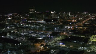 DX0002_205_015 - 5.7K stock footage aerial video reverse view of the skyline near arena parking lots at night, Downtown Buffalo, New York