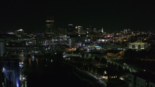 DX0002_205_017 - 5.7K stock footage aerial video of flying past the downtown skyline at night, reveal grain elevators, Downtown Buffalo, New York