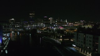 DX0002_205_018 - 5.7K stock footage aerial video of flying past grain elevator to reveal the downtown skyline at night, Downtown Buffalo, New York