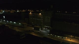DX0002_205_020 - 5.7K stock footage aerial video slowly orbit flour mill at night, Buffalo, New York